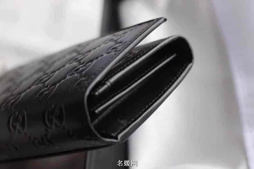 Gucci/古奇 GG Signature 织带装饰压花牛皮翻盖钱包 212186